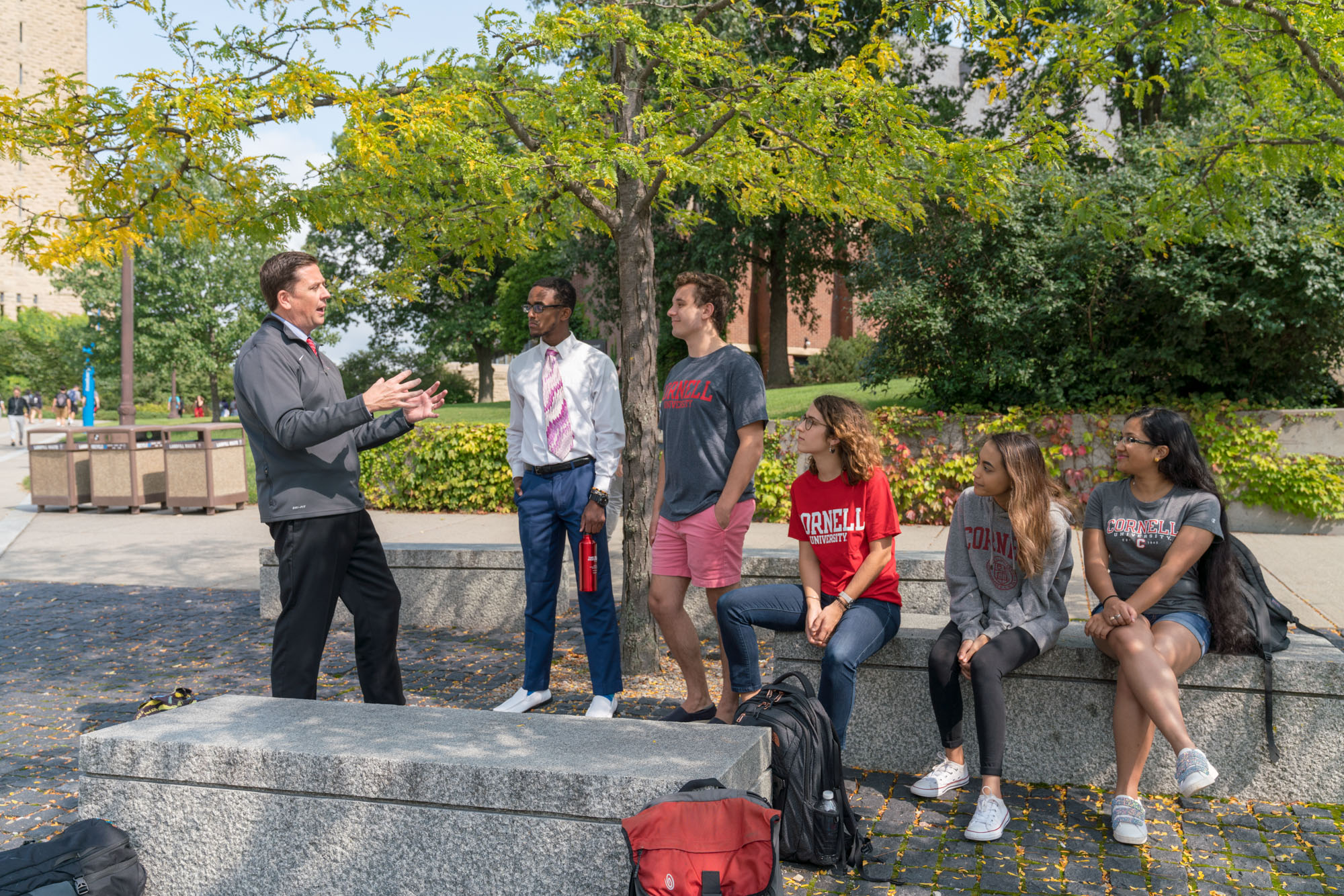 VP Ryan Lombardi talking with a group of students near Ho Plaza